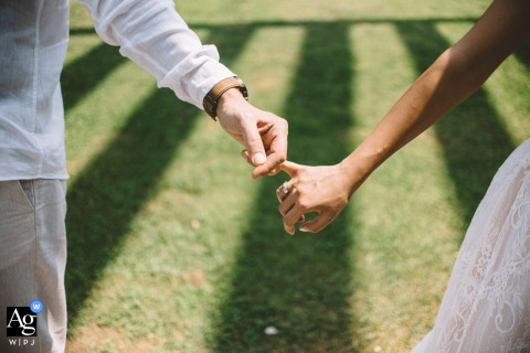A detail images of newlyweds holding hands in Athens, Greece