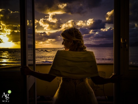 Sestri Levante fine art wedding portrait image of the bride looking out over the ocean from her room with a view