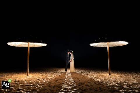 Corsica fine art wedding portrait image of A couple in the night with a black sky overhead