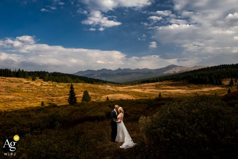 portrait of bride and groom with mountain backdrop and shadows in Eagle County, Colorado