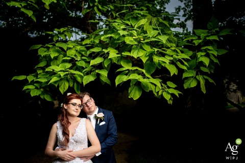 Zámek Lysice artistic wedding couple portrait below a Cloud of heart shaped leaves