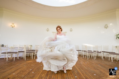 The bride having fun with her wedding dress at the reception location at the Barton Hall, Kettering, Northants
