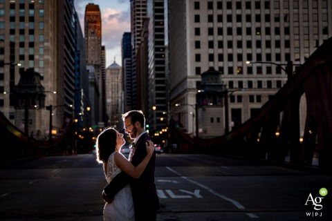 River Roast, Chicago, IL creative wedding day backlit shot of a couple on a bridge