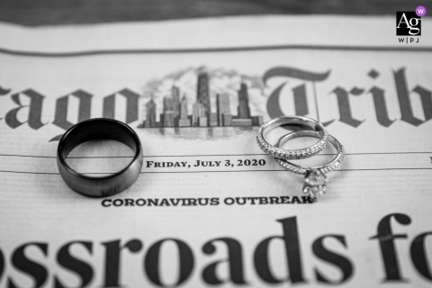 Chicago wedding detail image of the couple's rings sitting on a Chicago Tribune newspaper