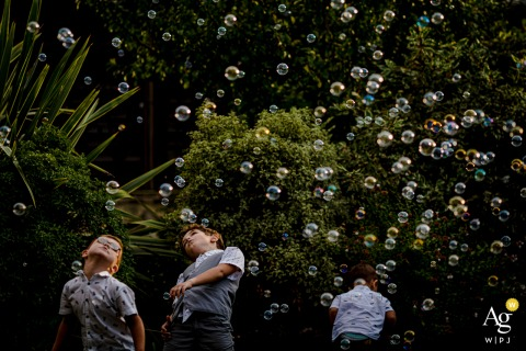 Mas de France, Montpellier, france wedding children play with bubbles at the reception party outdoors