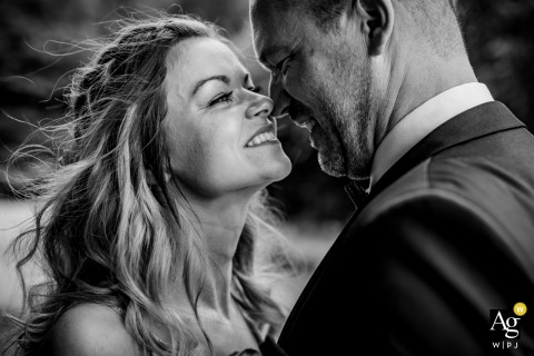 Heidesee Bottrop wedding couple portrait going nose to nose in black and white