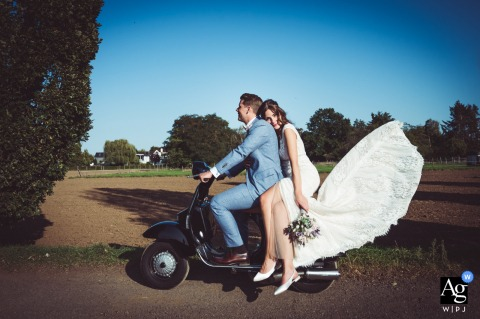 Meerbusch, Germany Wedding Couple posing on a motorbike scooter moped for a portrait
