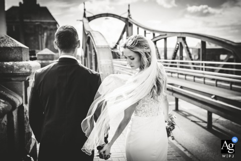 Krefeld, Germany Wedding Couple walking on the bridge for a portrait