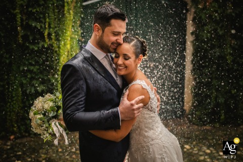 Bride and Groom in the rain during this Italy wedding portrait session