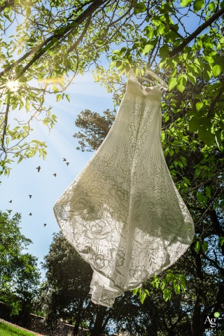 Aldea Santillana fine art wedding detail photography picture outside of the Wedding dress hanging on a tree