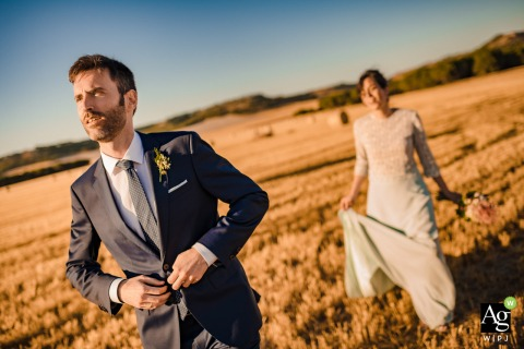Valladolid artistic wedding couple portrait of the Bride and groom at sunset standing in the open field