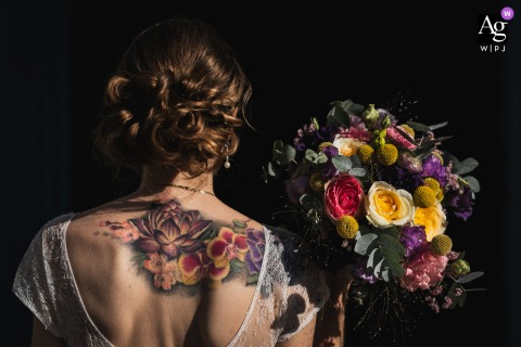 Arzon, France wedding portrait image of the tattooed bride and her bouquet