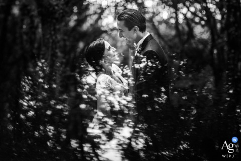 Portrait of the bride and groom in black and white in the woods of Mount Erice