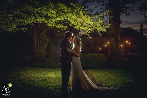 Scotland artistic wedding couple portrait of the B&G backlit under tree
