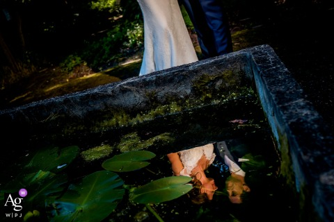 Netherlands couple photoshoot venue in the park with reflection in the water during the photo shoot