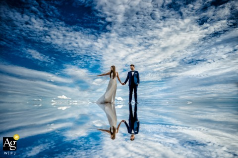Hambacher Schloss wedding portrait of the bride and groom with clouds as their backdrop and reflected