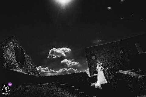 Gleiburg bride and groom artistic wedding portrait under the sky and clouds