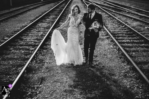 Žalec, Slovenia Couple standing close to the railway tracks during a black and white wedding portrait session