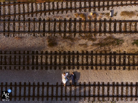 Žalec, Slovenia Drone wedding photo of the couple almost standing on the tracks