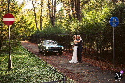 Wroclaw, Poland Couple, signs and mustang 66 in this artistic wedding photo