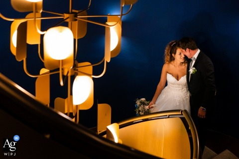 Portopiccolo, Trieste, Italy Blue and yellow artistic wedding portrait of the bride and groom under lights
