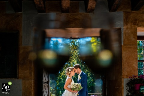 Castello di Strassoldo, Udine, Italy fine art wedding portrait image using the Bride and groom in the middle of the glasses