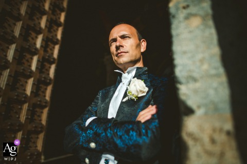 artistic wedding photo at the Ceremony Location - Palazzo Pubblico Siena ITALY in this Groom's Portrait