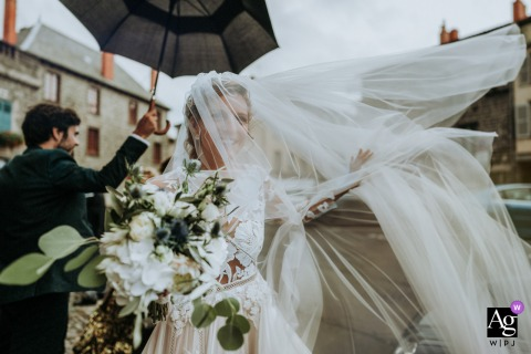 church of Saint Flour France wedding image showing the veil of the flying bride