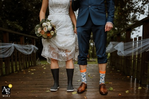 artistic wedding photo of the bride and groom's shoes and socks at Moulin du Champ France