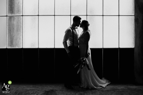 Belgium black and white wedding portrait from an Abandoned factory showing the posed couple during the shoot