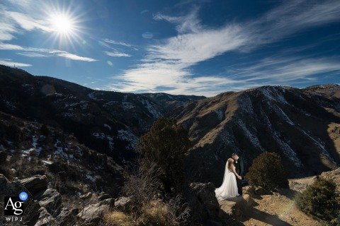 Colorado couple at a mountain overlook in this artistic wedding photo On the way to the ceremony