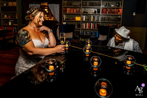 Ace Gillett's, Fort Collins, CO	Groom plays piano for his new bride in a speakeasy in this wedding day portrait with candles