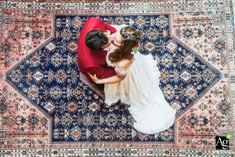 Chateau de Valery, Chambre Nuptiale artistic wedding couple portrait from overhead of a hug on the carpet