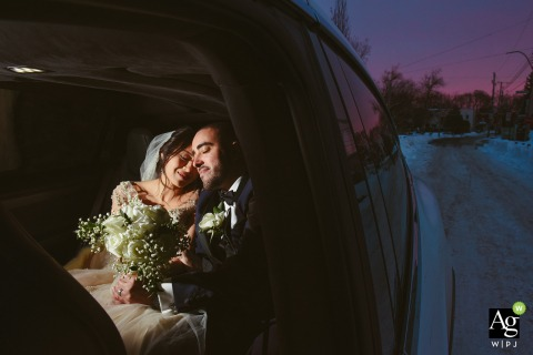 Montreal, Quebec creative wedding day portrait of the Bride and groom together inside a lit car