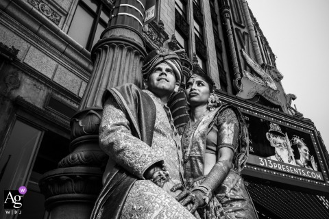 Fox Theater, Detroit, MI Portrait of bride and groom from a low angle in black and white