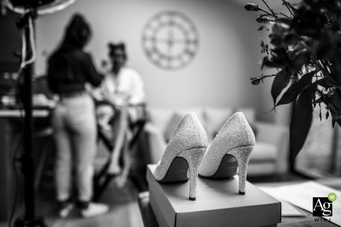 East Yorkshire, England wedding reportage detail photography from the getting ready of the glittery shoes with bride getting makeup done in background