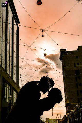 Downtown Detroit, Michigan Portrait of the bride and groom under a soft, pastel sky