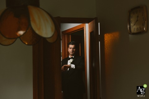 Montreal, Quebec fine art wedding portrait image of the Groom getting ready in his parents home