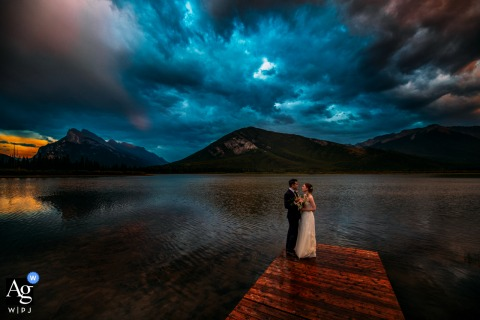 Vermilion Lakes, AB, Canada	wedding day Sunset portrait of the bride and groom on a wooden dock