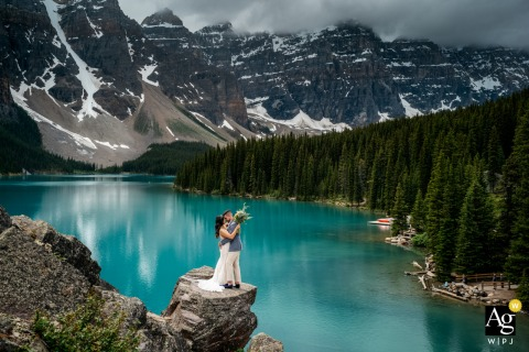 Moraine Lake, AB, Canada artistic wedding photography of a couple portrait above the water and lake