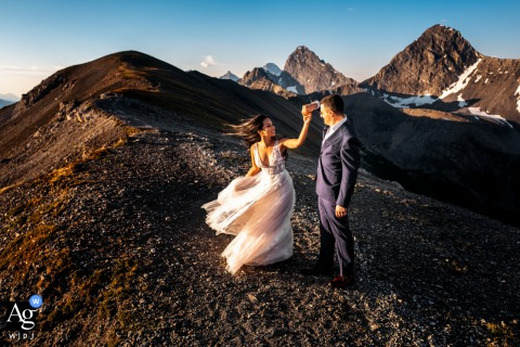 Tent Ridge, Kananaskis, AB, Canada artistic wedding portrait of the bride and groom in Golden light