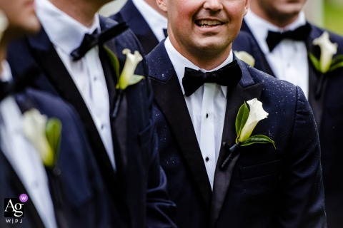 Donnel Lake Michigan state wedding image of the groomsman details with the rain
