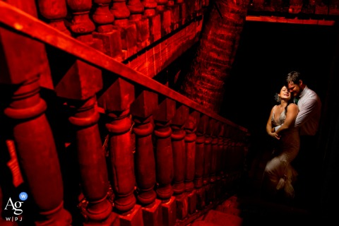 "Hacienda Siesta ALegre wedding photographer ""Use the stairs as a leading line and added a red gel for contrast"""
