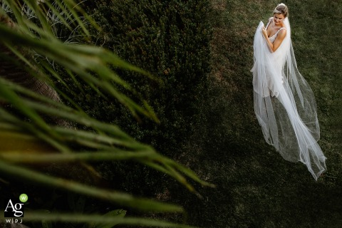 Casa da Noiva fine art wedding portrait image from the House of the Bride	as she is spinning her veil on the lawn