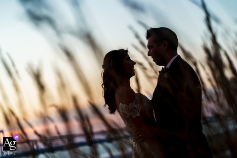 belle Mer Wedding Reception couple portrait at sunset with beach sea grass