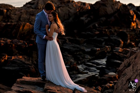 The bride and groom out on the rocks after their sunrise elopement at Marginal Way in Ogunquit Maine