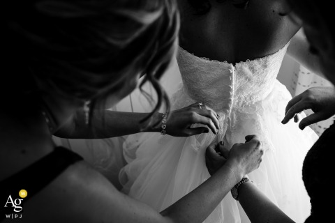 Philadelphia bride gets some help from her mom and sister putting on her wedding gown