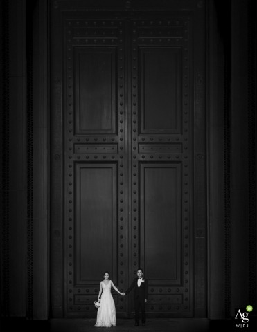 National Archive Museum bride and groom posing during a portrait session before a bw Big door