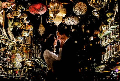 Granada - Spain artistic wedding photo of the couple embracing Between lights