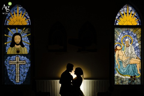 Seattle, WA bride and groom posing during a portrait session with some stained glass windows